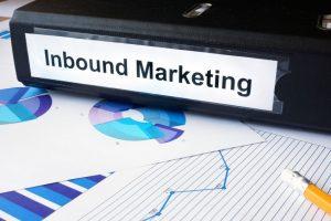 Graphs and file folder with label Inbound Marketing.